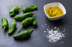 Raw green hot mexican peppers jalapeno pimientos padron spanish tapas Stock Photo