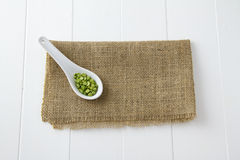 Green lentils in spoon Stock Image