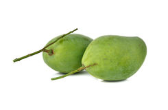 Raw green mango with stem on white. Background Stock Photo