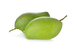 Raw green mango with stem on white background. Raw green mango with stem on a white background Royalty Free Stock Image