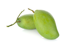Raw green mango with stem on white background. Raw green mango with stem on a white background Stock Photos