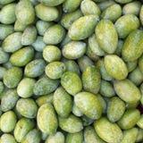 Raw green olives closeup Stock Photos