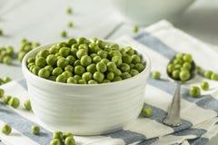 Raw Green Organic English Peas Stock Photos
