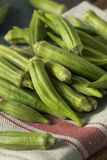 Raw Green Organic Okra Harvest. Ready to Cook With Royalty Free Stock Photography