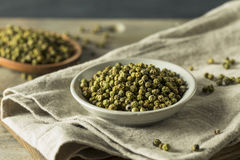 Raw Green Organic Peppercorns. Ready to Cook With Stock Photo