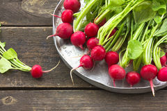 Raw Green Organic Radish on wooden table Stock Photo