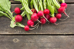 Raw Green Organic Radish on wooden table Stock Photos