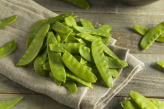 Raw Green Organic Snow Peas. Ready to Eat Stock Images