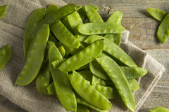 Raw Green Organic Snow Peas. Ready to Eat Royalty Free Stock Photo