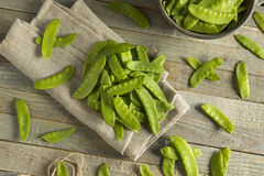 Raw Green Organic Snow Peas. Ready to Eat Stock Photos