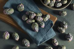 Raw Green and Purple Brussel Sprouts. Ready to Cook Royalty Free Stock Photo