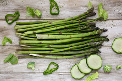 Raw green vegetables on a rustic white table Stock Photos