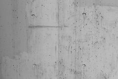 Exposed concrete with pattern texture. Raw grey exposed concrete with pattern texture background Stock Photo