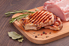 Raw and grilled meat. With spices on a  wooden board Royalty Free Stock Photography
