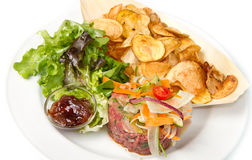Raw ground beef. With chips and salad Stock Photography