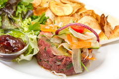 Raw ground beef. With chips and salad Royalty Free Stock Photo