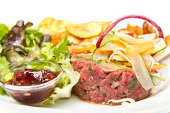 Raw ground beef. With chips and salad Royalty Free Stock Photography