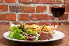 Raw ground beef. With chips and salad Royalty Free Stock Image
