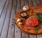 Raw ground beef for burgers cooking with spices Royalty Free Stock Photo