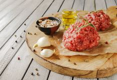 Raw ground beef for burgers cooking with spices Royalty Free Stock Image