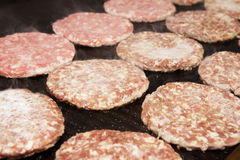 Raw Ground beef meat Burger. Barbecue in process Royalty Free Stock Photo