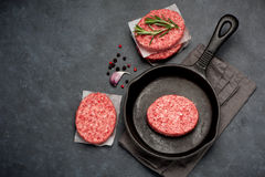 Raw Ground Beef Meat Burger cutlets. Top view. Raw Ground Beef Meat Burger cutlets on black background. Top view Royalty Free Stock Photos