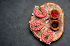Raw Ground Beef Meat Burger cutlets. Top view Stock Photography