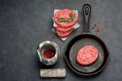 Raw Ground Beef Meat Burger cutlets. Top view Royalty Free Stock Images