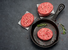 Raw Ground Beef Meat Burger cutlets. Top view. Beef Meat Burger cutlets on the black background Royalty Free Stock Image