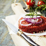 Raw Ground beef meat Burger steak cutlet. With seasoning on vintage wooden boards Stock Photography