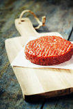 Raw Ground beef meat Burger steak cutlet. On vintage wooden boards Royalty Free Stock Photography