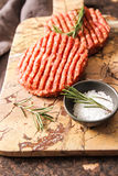 Raw Ground beef meat Burger steak cutlets. On a background stone Stock Images