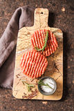 Raw Ground beef meat Burger steak cutlets. On a background stone Stock Image