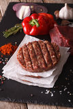 Raw Ground beef meat Burger steak cutlets. Vertical closeup. Raw Ground beef meat Burger steak cutlets with ingredients on the board. vertical closeup Stock Images
