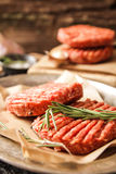 Raw Ground beef meat Burger steak cutlets. On  wooden background Royalty Free Stock Photos