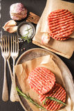 Raw Ground beef meat Burger steak cutlets. On  wooden background Stock Photos