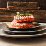 Raw Ground beef meat Burger steak cutlets. On  wooden background Royalty Free Stock Photography