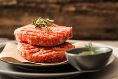 Raw Ground beef meat Burger steak cutlets. On  wooden background Royalty Free Stock Image