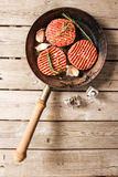 Raw Ground beef meat Burger steak cutlets. On  wooden background Stock Photography