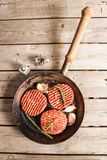 Raw Ground beef meat Burger steak cutlets. On  wooden background Stock Images