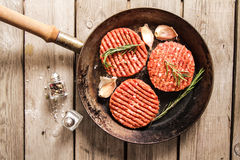 Raw Ground beef meat Burger steak cutlets. On  wooden background Royalty Free Stock Photo