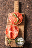 Raw Ground beef meat Burger steak cutlets. On  wooden background Stock Image