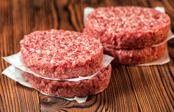 Raw ground beef meat hamburger patties on paper,  Stock Photography