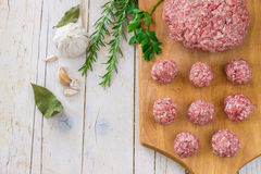 Raw ground beef meat steak cutlets with herbs and spices on whit. E table or board for background. Healthy eating Stock Image