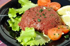 Raw ground beef with vegetables Royalty Free Stock Photos