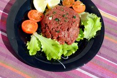 Raw ground beef with vegetables Royalty Free Stock Image