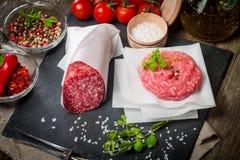 Raw Ground meat Burger and salami Stock Photos
