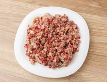 Raw ground meat on a white plate. Minced meat from pork and chicken on a plate Royalty Free Stock Photo