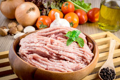 Raw ground meat in wood bowl. Royalty Free Stock Images