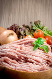 Raw ground meat in wood bowl. Royalty Free Stock Photo